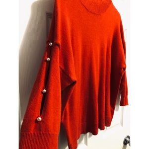 Red Sweater with Pearl Accents